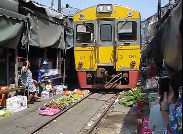 The train rolls right through the market!