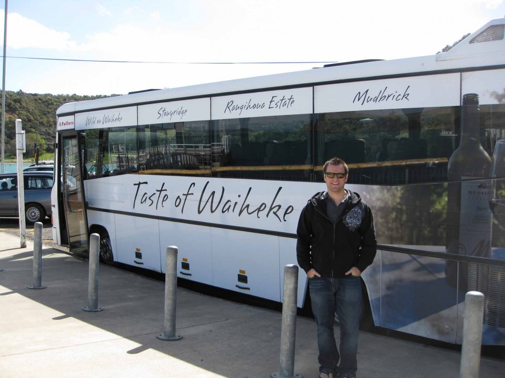 man standing next to a bus