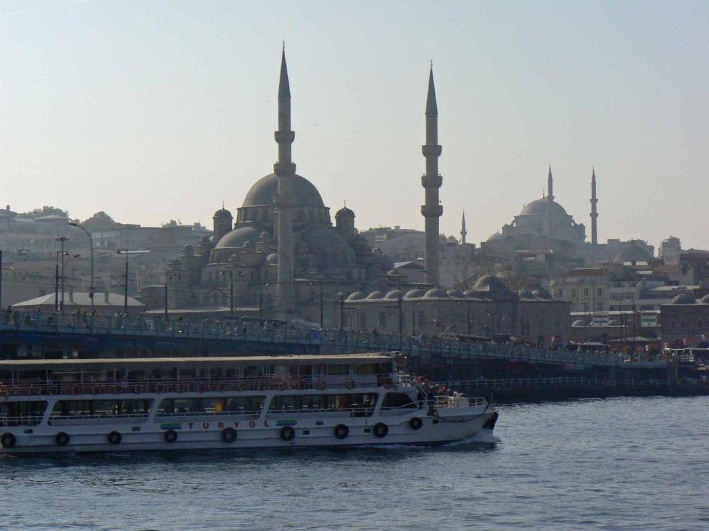 ferry boat floats past blue mosque