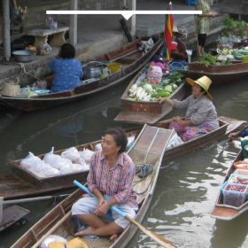 Visit the floating markets of Thailand
