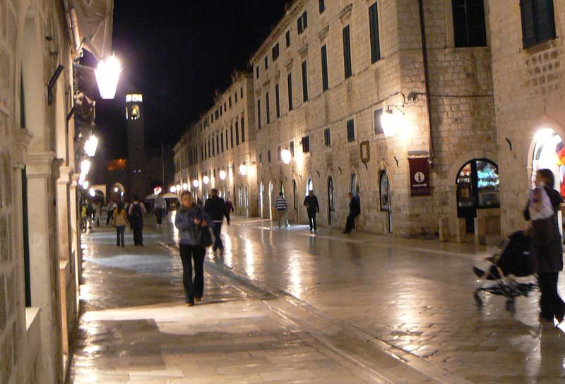 The streets of Dubrovnik shine in the lamp light