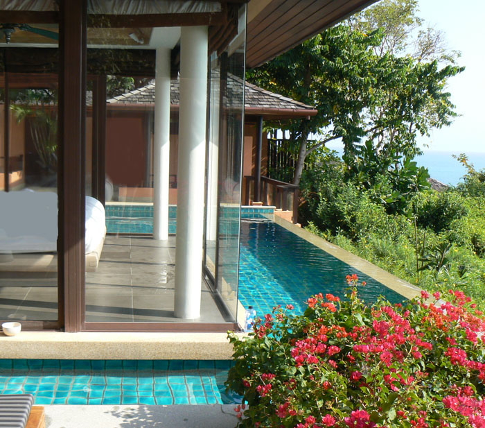 Wrap-around infinity pool and cabana at Sri Panwa