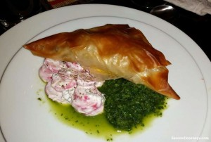 Veal-stuffed pastry with mint chutney and radishes