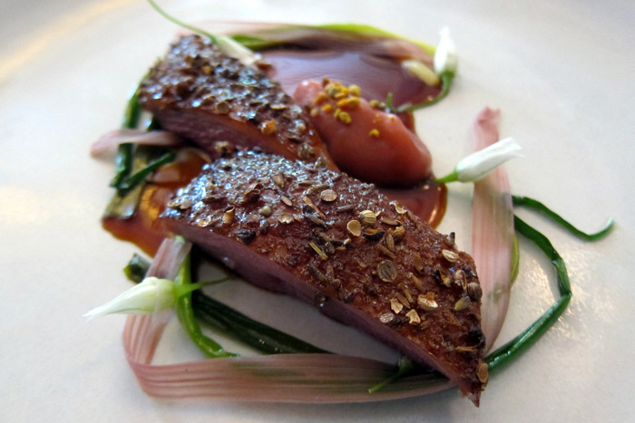 Finger Lakes Duck, dry-aged, with spring onion, rhubarb and citrus duck jus at Eleven Madison Park