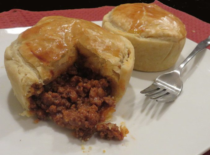 Australian Meat Pie can be picked up and eaten with your hands. It's often served with a dollop of ketchup on the top.