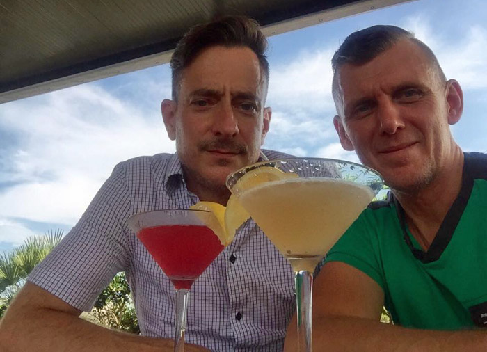 David Shelby and Corey Hewitt relaxing with a cocktail during one of their food crawl stops at Stars Rooftop ba