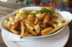 Poutine (fries with gravy and melted cheese curds) served in Canada