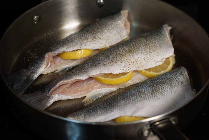 If cooking inside, add fish to a pre-heated pan on high heat.