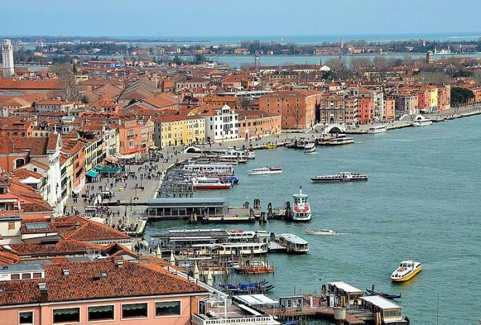 Venice, Italy, is surrounded by waterways, making it an extremely unique and interesting place to visit.