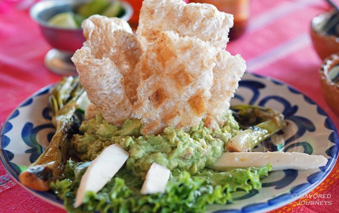 Guacamole with chicharons and cheese