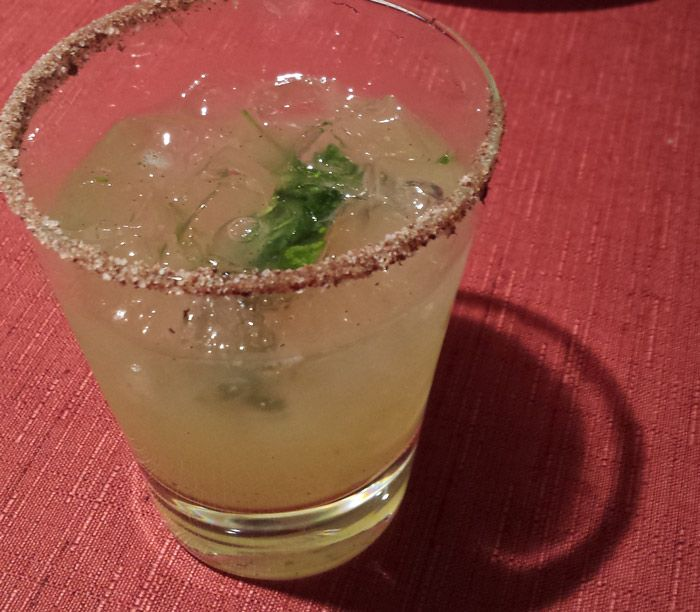 My new favorite cocktail, made with lime, agave, mezcal and basil.