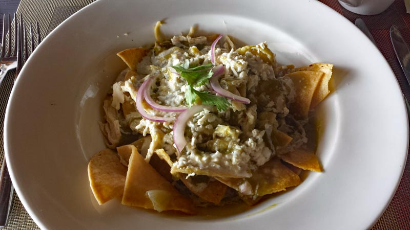 Chilaquiles with chicken and green chile sauce
