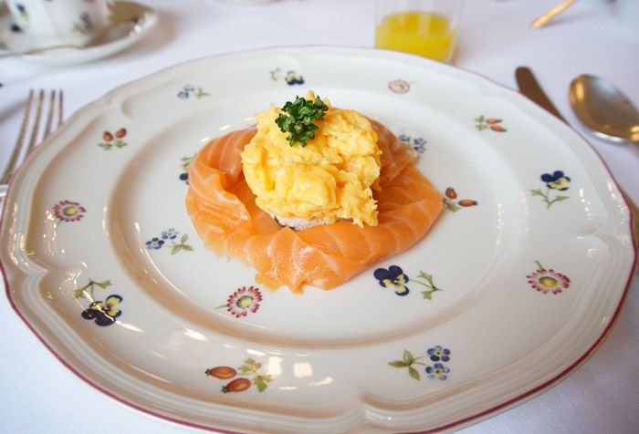 Scrambled eggs on toast with smoked salmon.