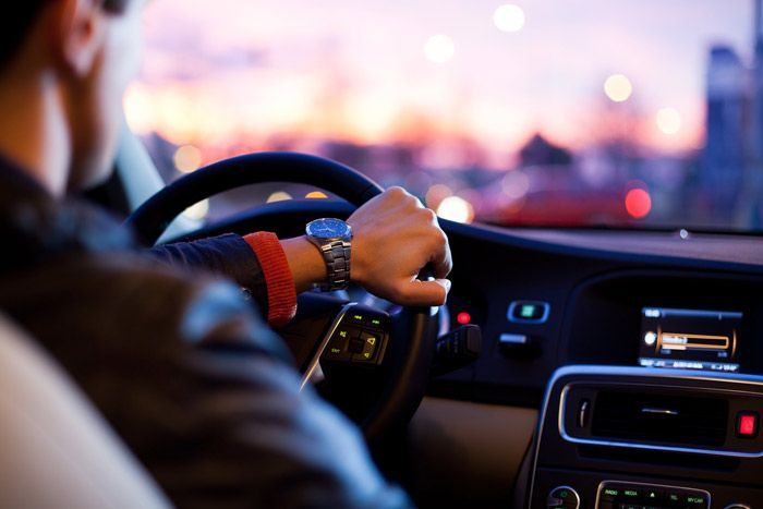 Use Blacklane to pre-arrange a driver for a ride home from the airport