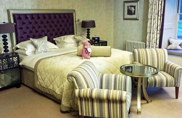 Our plush room at The Manor House included luxurious bedding and a seating area.