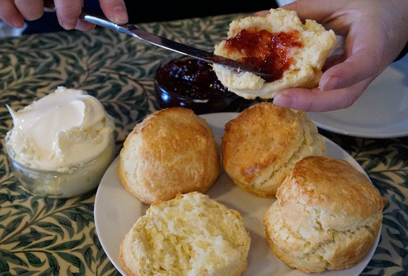 Loading up the scones at Carnewas Tea Rooms