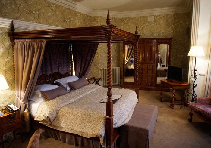 Each unique bedchamber is decorated with plush bedding and great architectural detail.