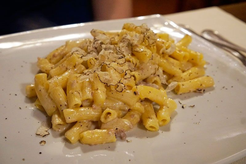 Short pasta with sausage and truffle sauce