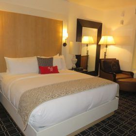 Hotel Valencia's King room has a comfortable bed and sitting area