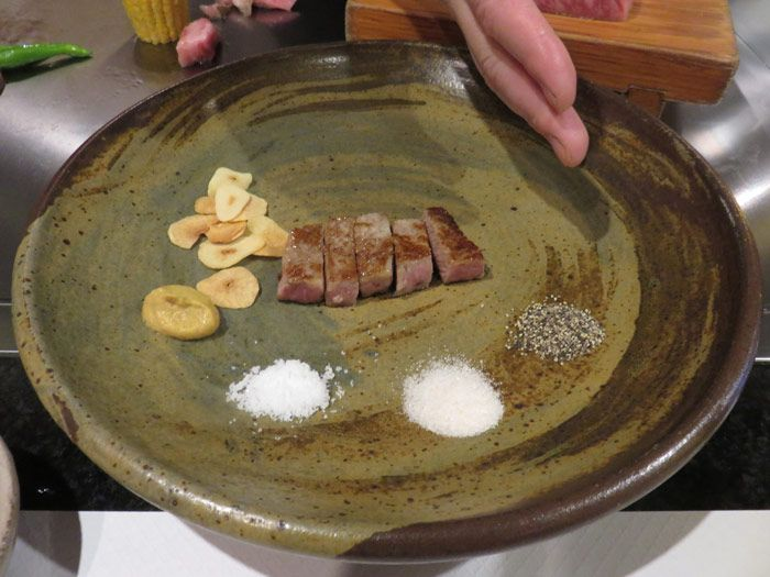 The beef was served with salt, pepper and fried garlic slices