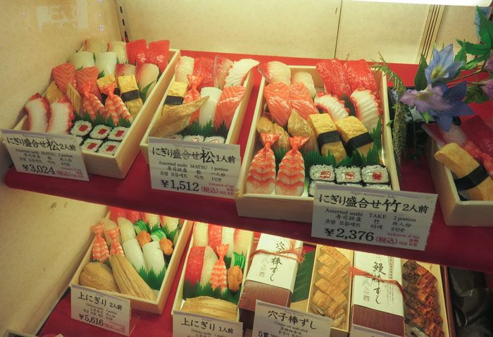 Plastic displays of sushi