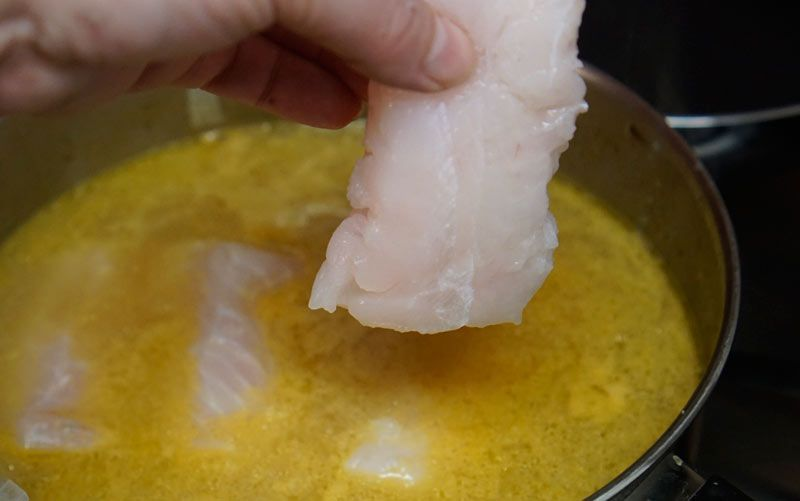 Add the fish to the broth