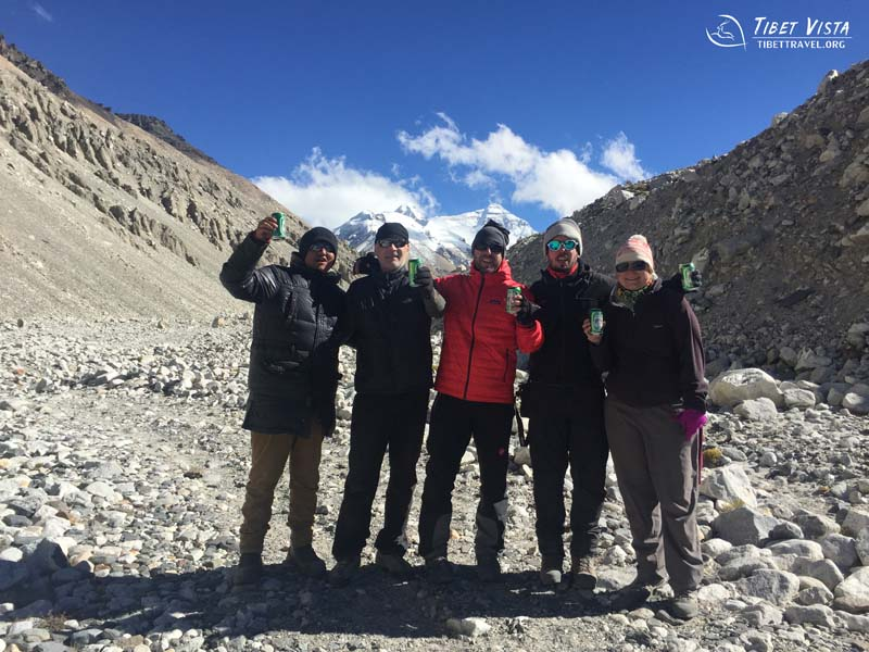 Tourists toast for peace and good health at Everest Base Camp with Lhasa beer