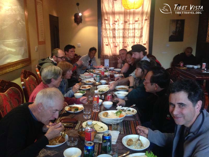 International tourists are enjoying the traditional Tibetan cuisines in Lhasa.