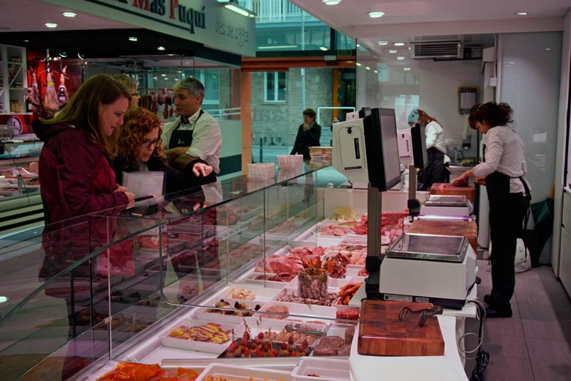 Choosing meat in the Mercado de Olot to cook for lunch