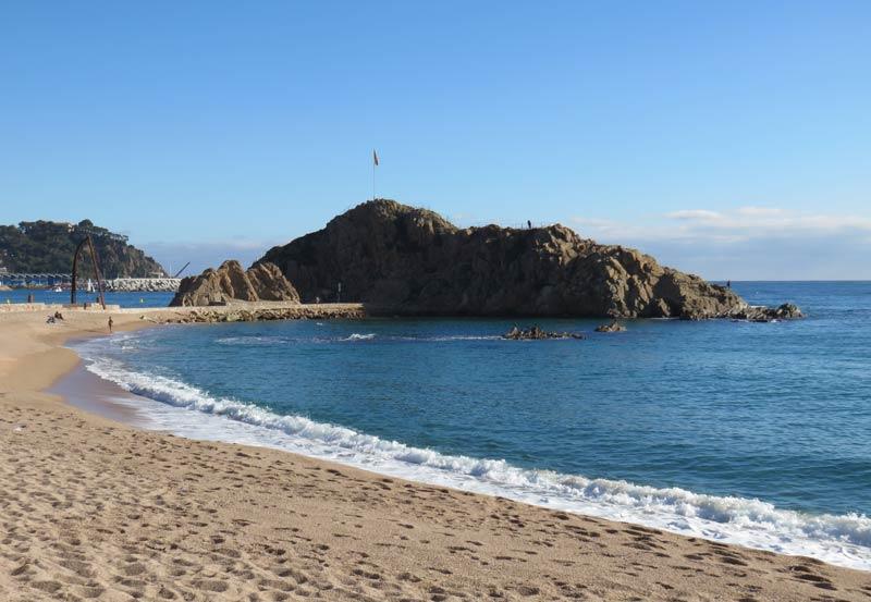 Sa Palomera rock outcropping on the Blanes beach