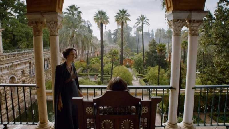 Ellaria staning on the balcony of the Alcazar de Sevilla