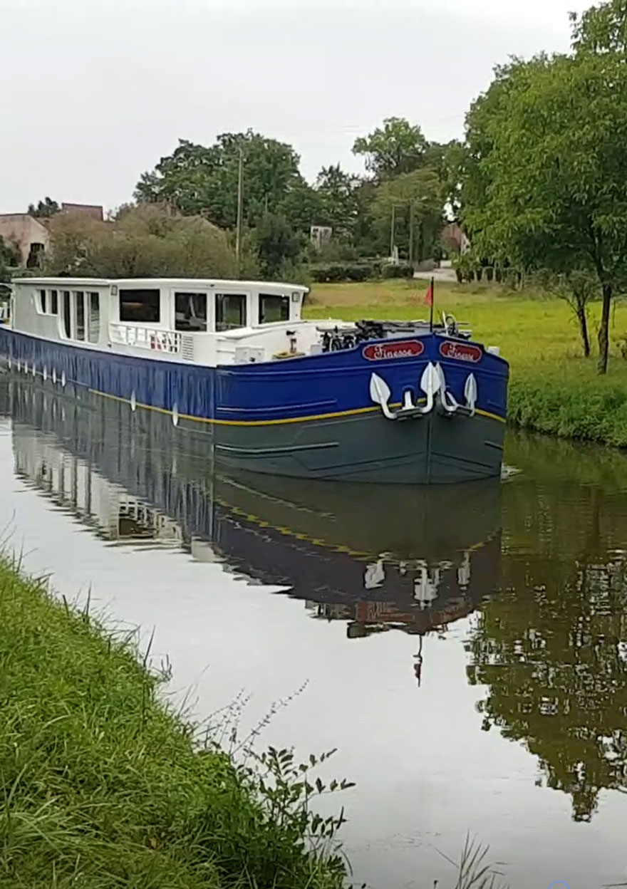 Luxury barge cruising down the Canal du Centre