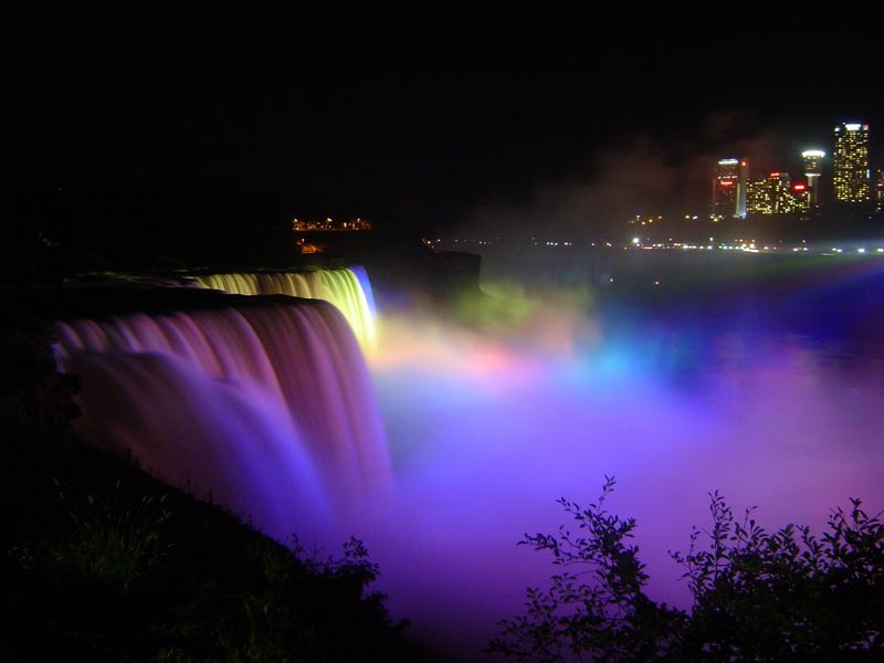 The falls light up at night, creating an impressive view
