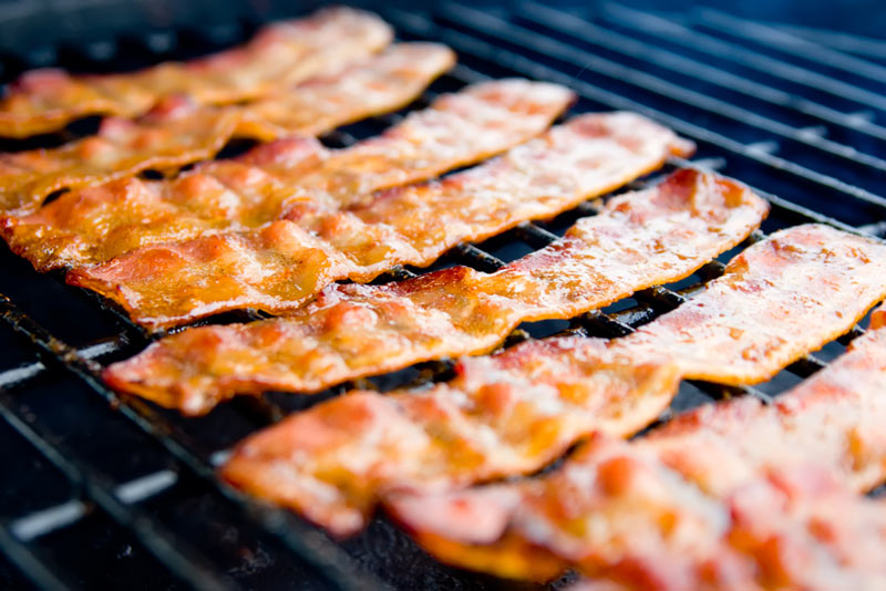 Bacon cooking on a grill