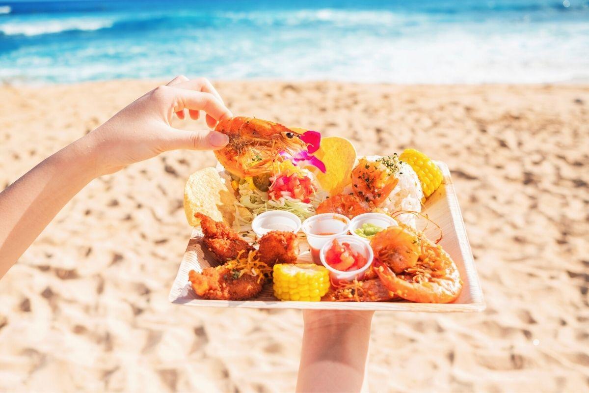 Plate of shrimp on a beach